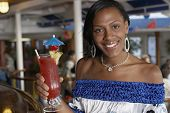 Mixed Race woman holding cocktail