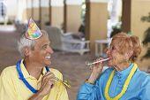 Senior couple at birthday party