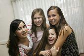 Multi-ethnic girls hugging