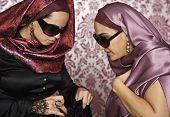 Middle Eastern women looking in purse