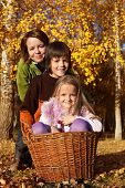 Autumn family portrait - preparing to gather the leaves in the garden