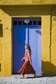 Hispanic woman walking on sidewalk