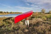 pic of collins  - portaging canoe between lakes - JPG