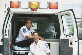 pic of ambulance  - African female and male EMTs in ambulance - JPG