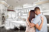 picture of combinations  - Young Military Couple Looking Inside Custom Kitchen and Design Drawing Combination - JPG