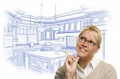 Daydreaming Woman With Pencil Over Custom Kitchen Design Drawing Isolated on White.