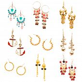 Set of various earrings isolated on white
