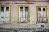 The Three Windows Of Old House With Shutters