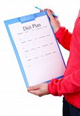 Sports trainer with diet plan isolated on white