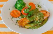 image of salmon steak  - steak of salmon served with green sauce and vegetable on plate  - JPG