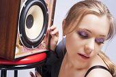 Sensual Caucasian Blond Woman Listening To Loudspeaker
