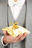 Man holding wedding rings close up