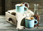 Beautiful composition with tasty cappuccino on wooden table