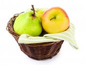Assortment of juicy fruits in wicker basket, isolated on white