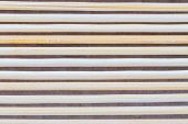 Close Up Macro Of Beige Brown Bamboo Mat As Striped Background Texture Pattern. Oriental