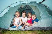 Children in a tent. Camping. Happy kids at summer vacations