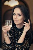 picture of table manners  - Portrait of a classical beauty toasting with a glass of champagne  - JPG