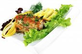 tuna steak on red porcelain dish with vegetables