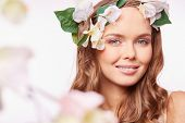 Charming woman with natural makeup wearing floral wreath