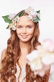 Charming girl with floral wreath on her head