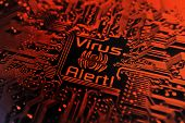 picture of virus scan  - Computer virus sign on red computer circuit board background - JPG