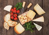 Assorted cheese on wooden table, rich and healthy snack or breakfast