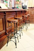 stock photo of stool  - Bar stools in a row by the counter - JPG