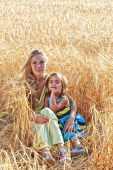 Mother With  Daughter In The Field