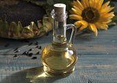 image of sunflower  - Sunflower seeds in the bag and sunflower oil in a bottle - JPG