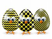Easter Yellow And Black Eggs Isolated Over White