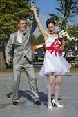 Cheerful and drunk Russian wedding. Newlyweds