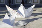 Paper boats in street.