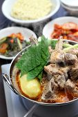 gamjatang, pork bone and potato soup, korean cuisine, simmering on the portable gas stove