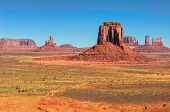 stock photo of orange  - Monument Valley West and East Mittens Butte Utah National Park - JPG