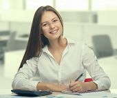 stock photo of secretary  - Young woman secretary at work at the office - JPG