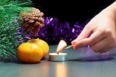 Christmas theme. Hand set fire to tea candle.