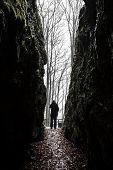 Man Exiting Dark Cave