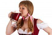 Oktoberfest waitress drinking beer