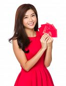 Asian Woman holds red pockets