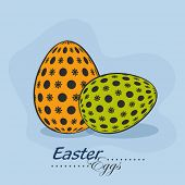 Beautiful decorated eggs on blue background for Happy Easter celebration.
