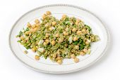 Freekeh salad with chickpeas, onion, parsley, celery, and a lemon juice and olive oil dressing