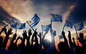Group of People Waving Uruguayan Flags in Back Lit