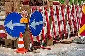 a road construction site. signs secure the site of a road from