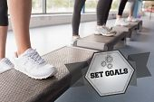 pic of step aerobics  - The word set goals and womens feet stepping in aerobics class against hexagon - JPG