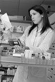 Woman Pharmacist With Prescription And Medicine