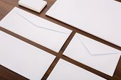 Blank Template. Consist of Business cards, letterhead a4, envelopes on wood table