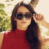 Fashion Woman With Long Hair In Modern Sun Glasses Outdoors