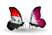 image of qatar  - Two butterflies with flags on wings as symbol of relations Syria and Qatar - JPG