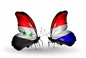 Two Butterflies With Flags On Wings As Symbol Of Relations Syria And Holland