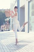 Happy Emotive Model Outdoor. Beige Blouse. White Shirt. Beige Leather Bag. High Heels